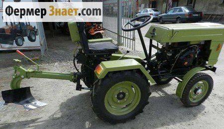 Traktor sa plug i mlin